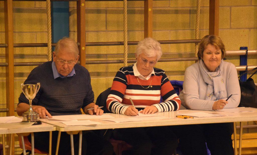 Rotarians John Bakes, Margaret Bakes and Carole Harrow keep the scores.