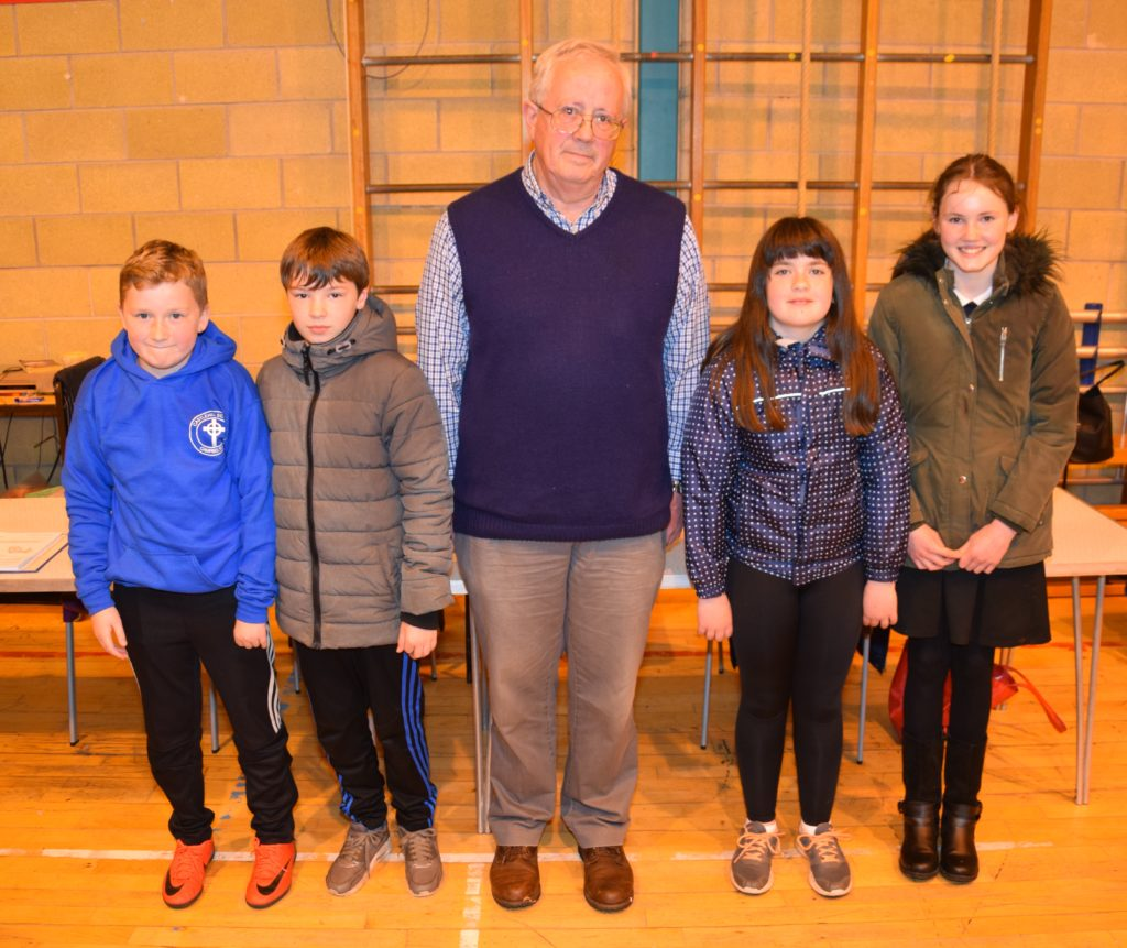 Second placed team, Castlehill One, with quiz master Alan Milstead.