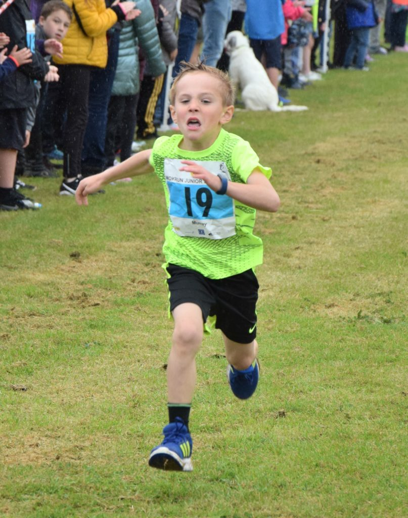 Determination in the face of record-breaker Murray Mackay as he approaches the finish line.