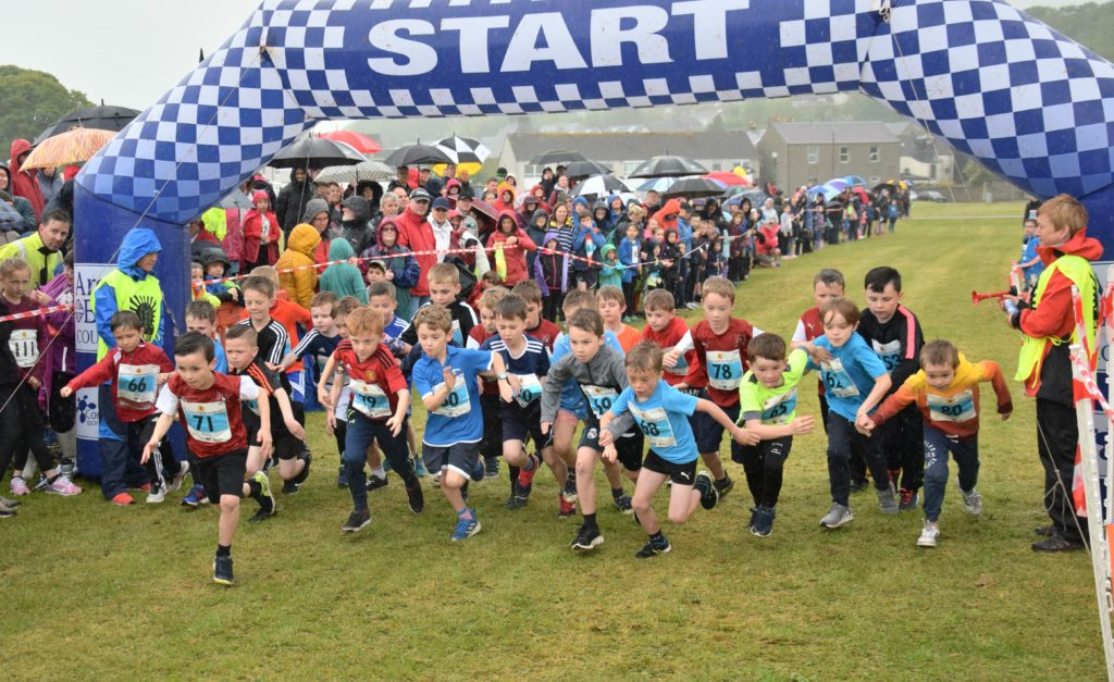 Seven to eight-year-old boys racing into action.