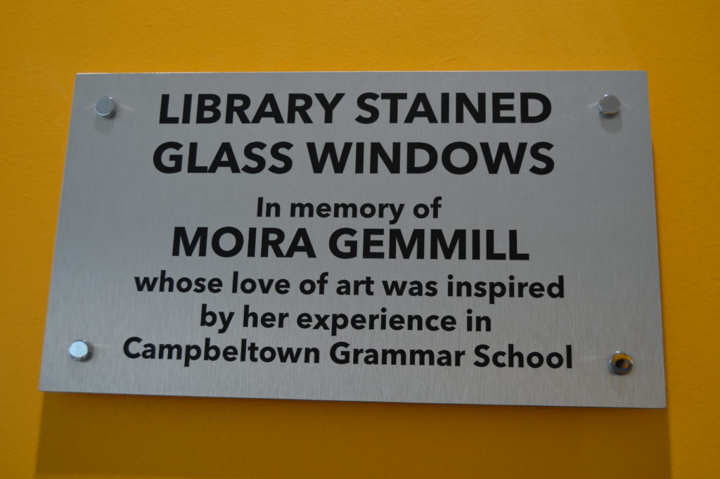 Stained glass in the school library is in memory of Moira Gemmill; it was professionally made with pupils helping with the design.