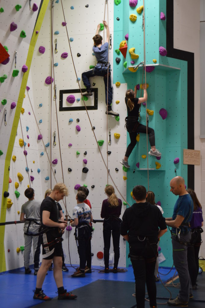 Pupils scale the climbing all under the watchful eye of Matthew Osborne, right, outdoor education and learning support.