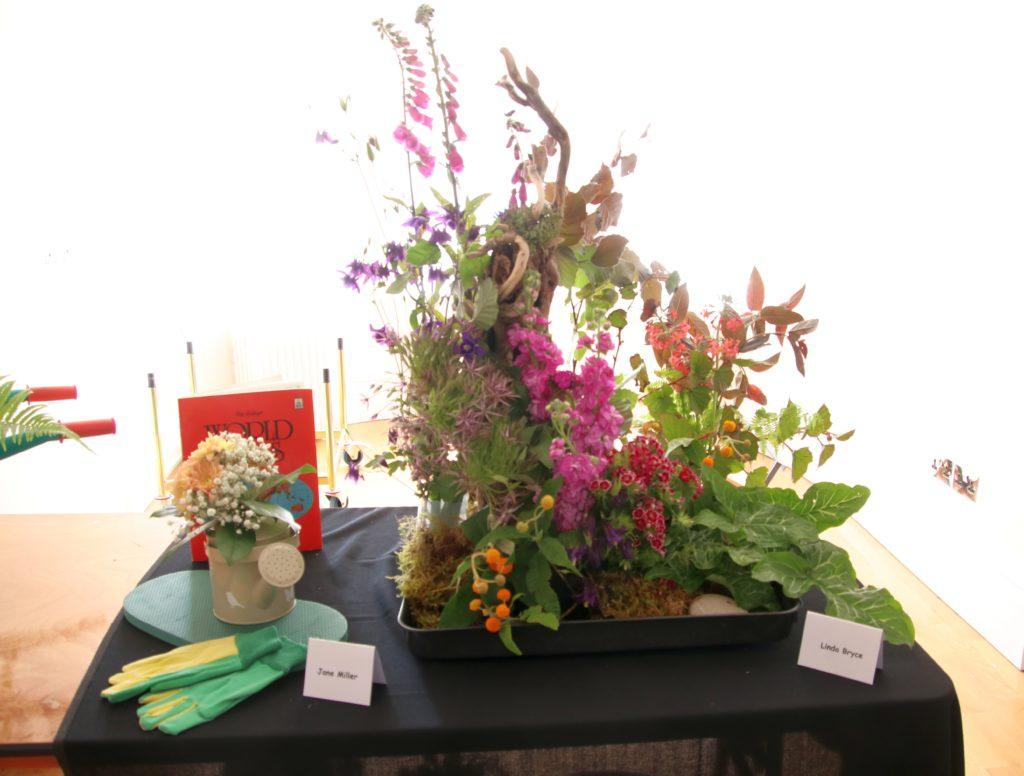 Displays by Jane Miller and Linda Bryce.