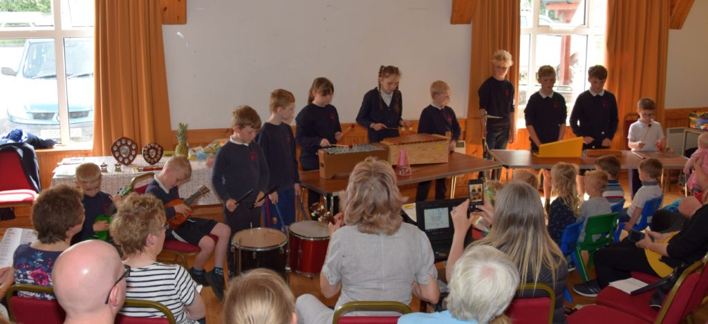 The school pupils performed a song using a variety of instruments.