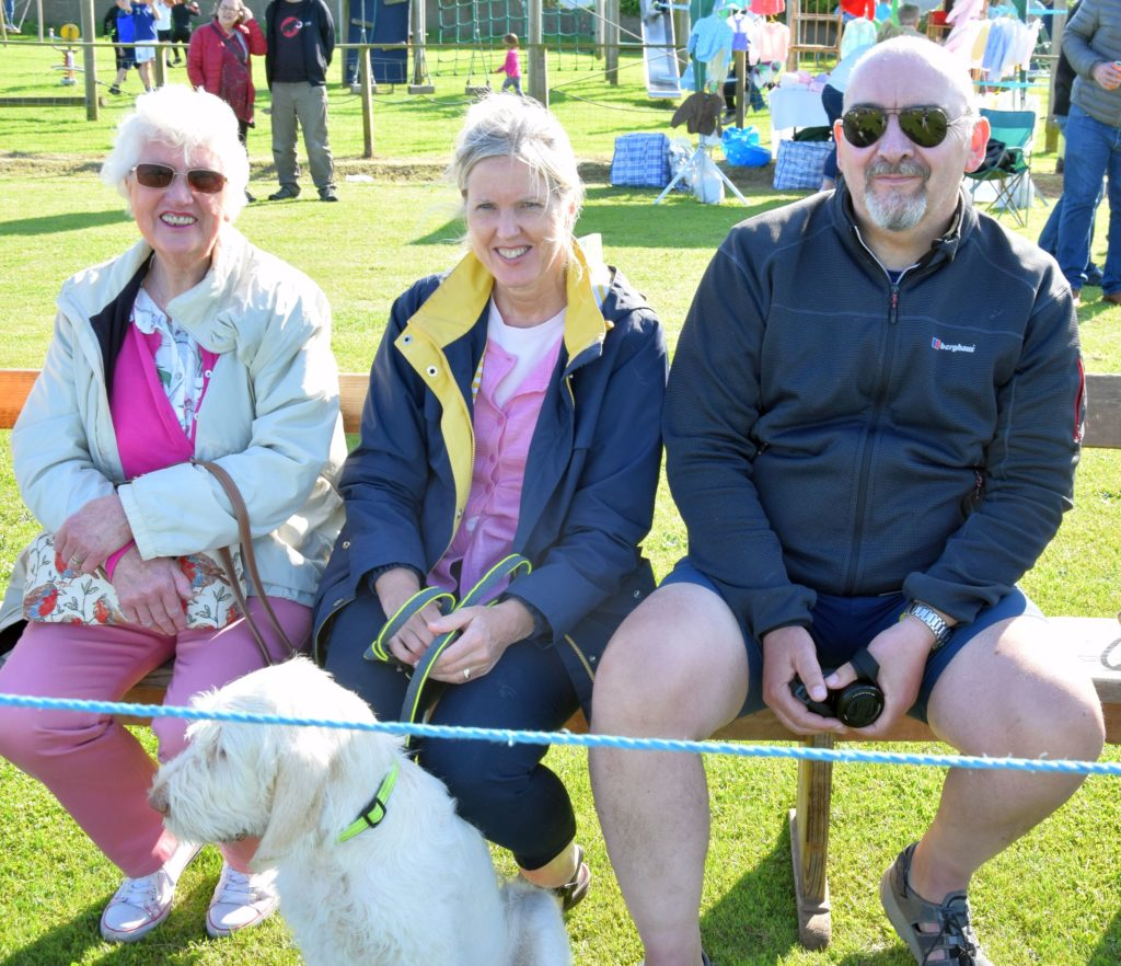 Jan Angus from Machrihanish with her daughter and son-in-law Corrine and Gordon Ross from Tain, with dog, Gigha, waiting for the games to begin.
