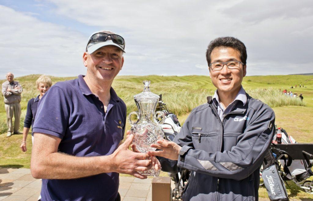Mr YC Kim of CS Wind UK presents the Campbeltown Open to an understandably delighted first-time winner, George MacMillan. Photo: John McFadyen.