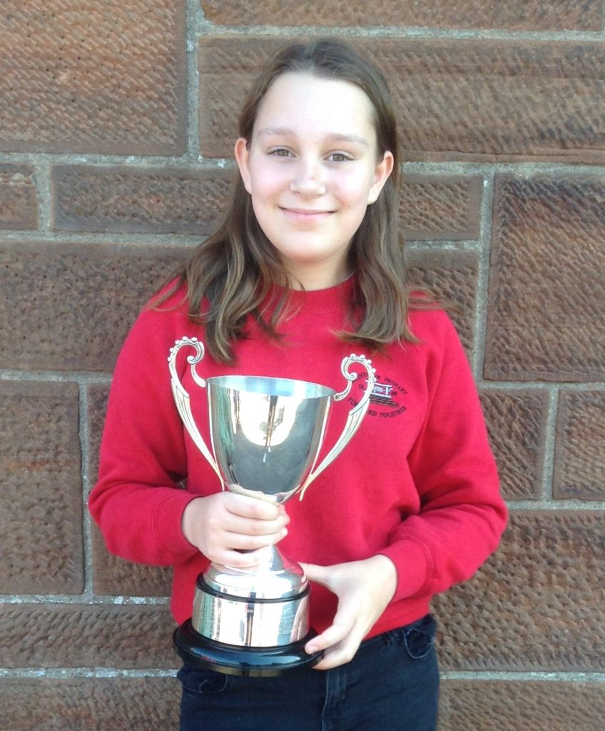 P7 Merit (Dux) Prize for girls, and winner of the Hector MacNeill Quaich for story writing, Lauren Docherty.