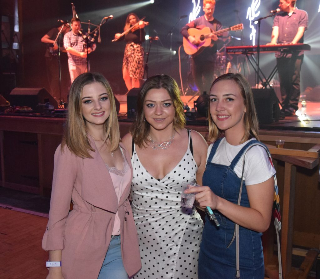 Nicola Wells, Caerla Cox and Kirsty Kennedy with Heron Valley on stage behind.