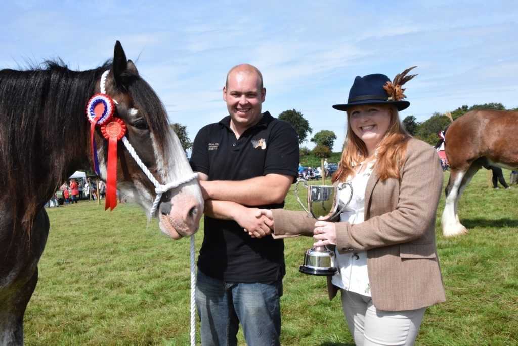 Callum MacPhail is presented with the Clydesdale championship trophy for his yeld mare Garcalfra Sweet Chloe by judge Amanda Stewart. 51_a33MAS25