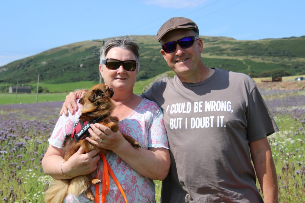Hilary and Andrew Rathey with their dog Kitty.