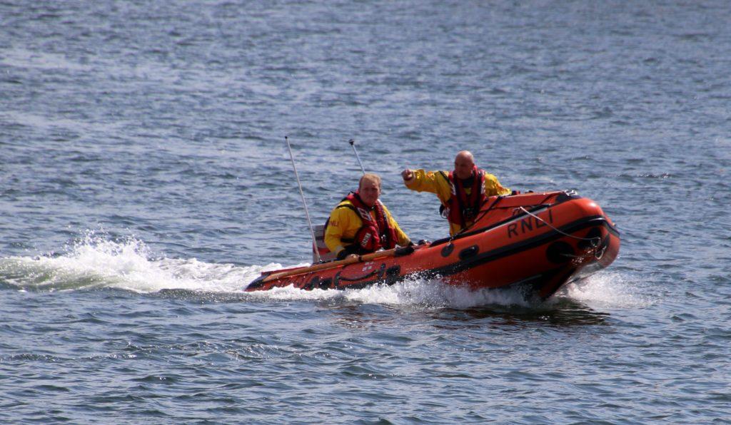RNLI volunteers Greg McMurchy and David Mullen patrolled the sea.