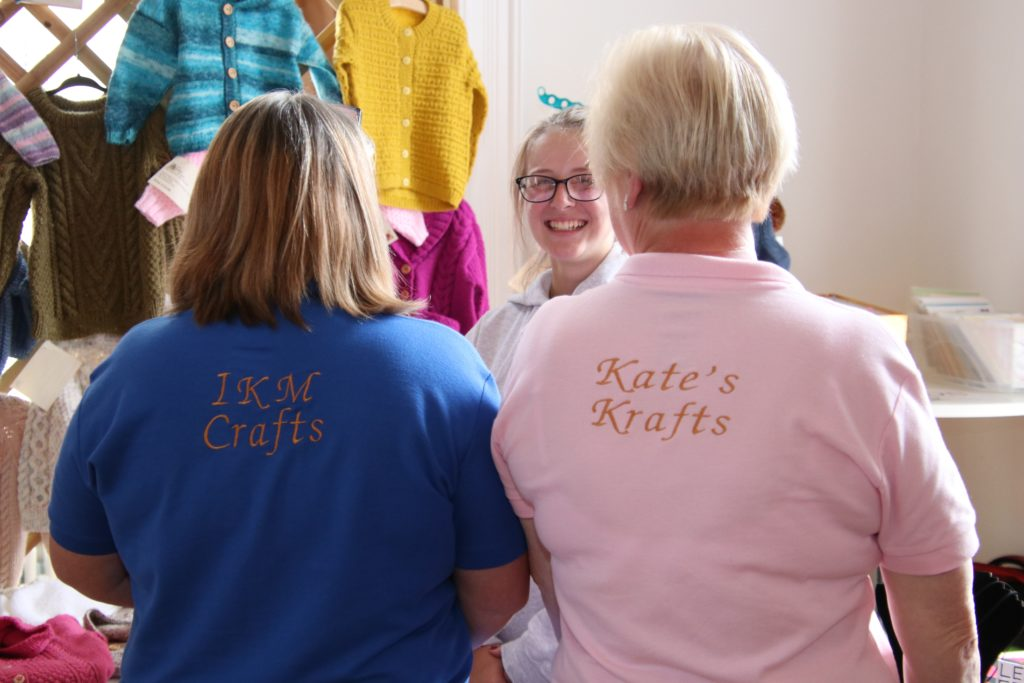 Andrina Mcaulay, left, and Kate O'May, right, with their specially branded T-shirts.