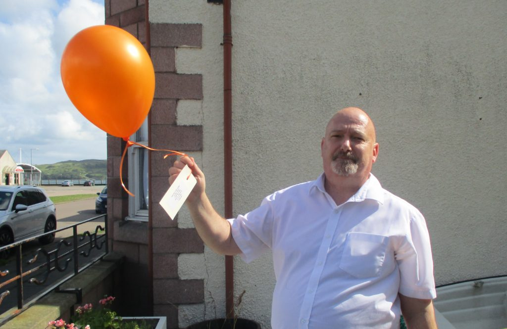 Care home manager Jason Woods got in on the action and released a balloon of his own.