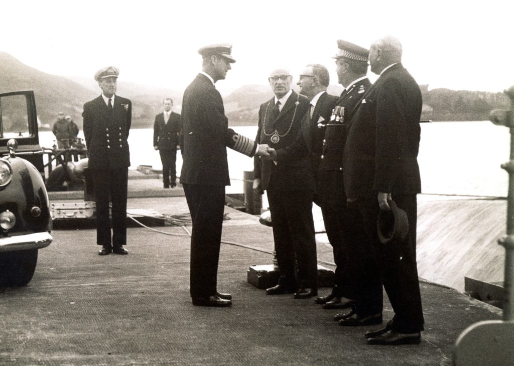 This photograph shows Prince Philip greeting staff and local figures at Campbeltown's oil fuel depot. Thomas, who was jetty supervisor, can be seen in the background, to the left of the prince.