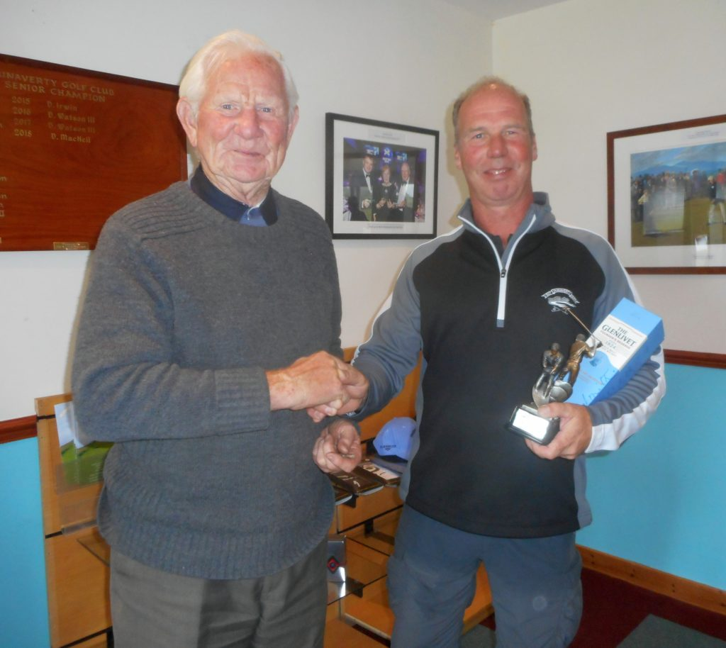 Last year's winner Sandy Watson presenting winner Donald Brown with his prizes.