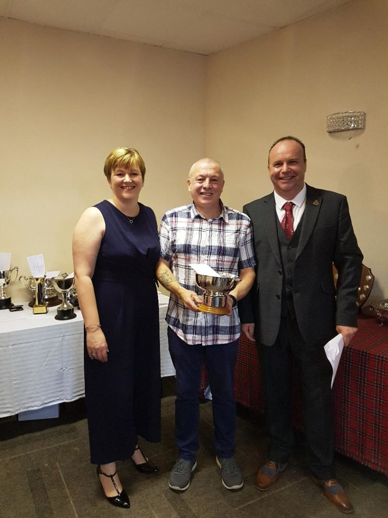 Stephen Kelly, McDairmid Cup winner, centre, with Willie and Kirsteen Ross.