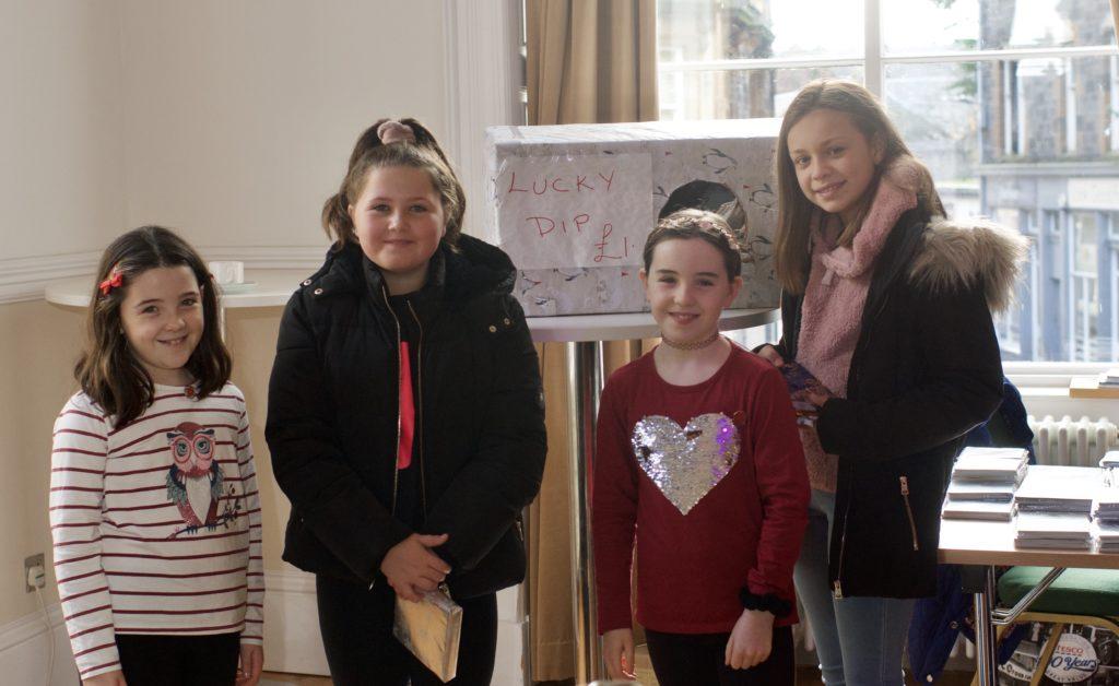 Amy Macpherson, Ella McGeachy, Cara Macpherson and Ivana Mati had a go at the lucky dip stall.