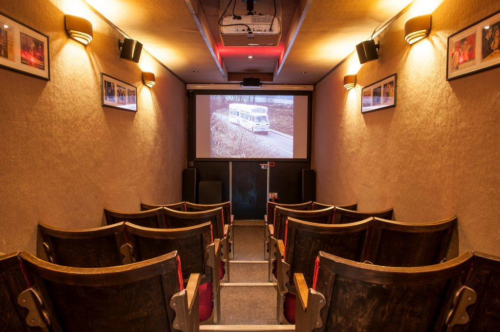 Cinema's crackle and hiss in period vintage vehicle