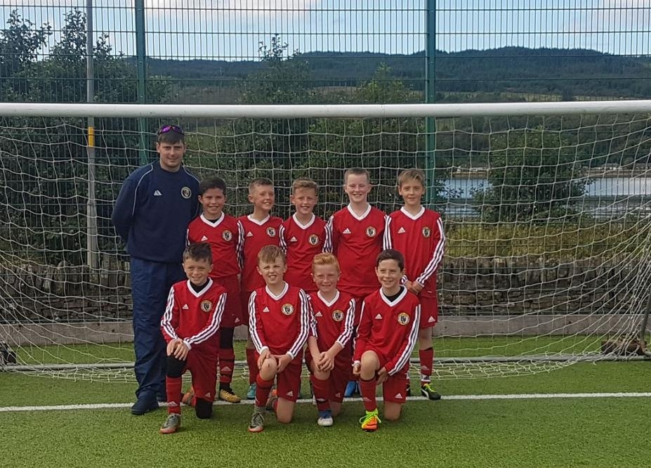 Young footballers compete against county rivals