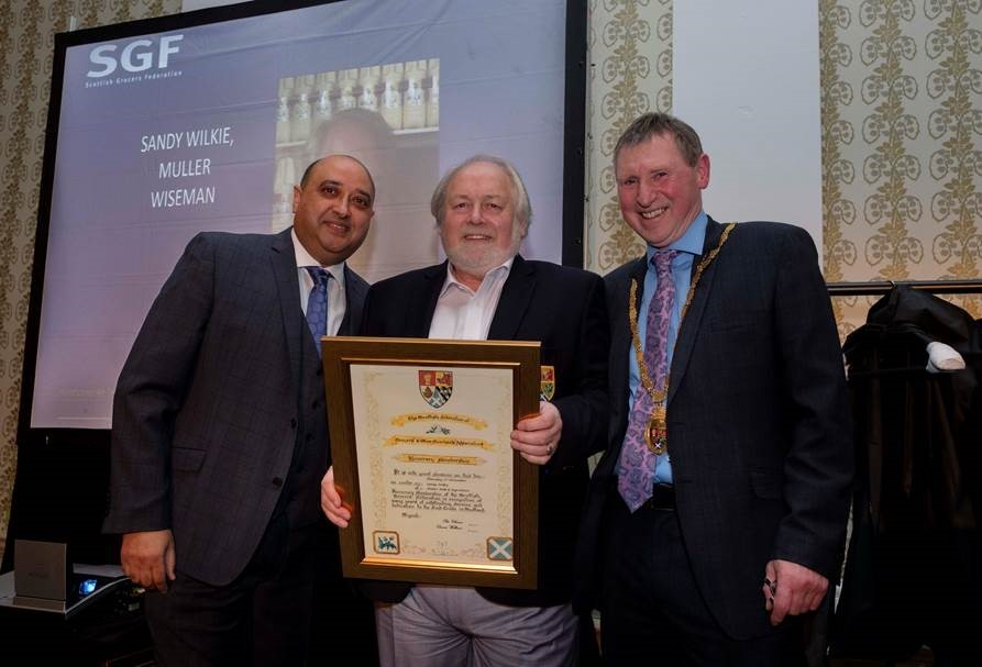 Dairy leader is honorary grocer