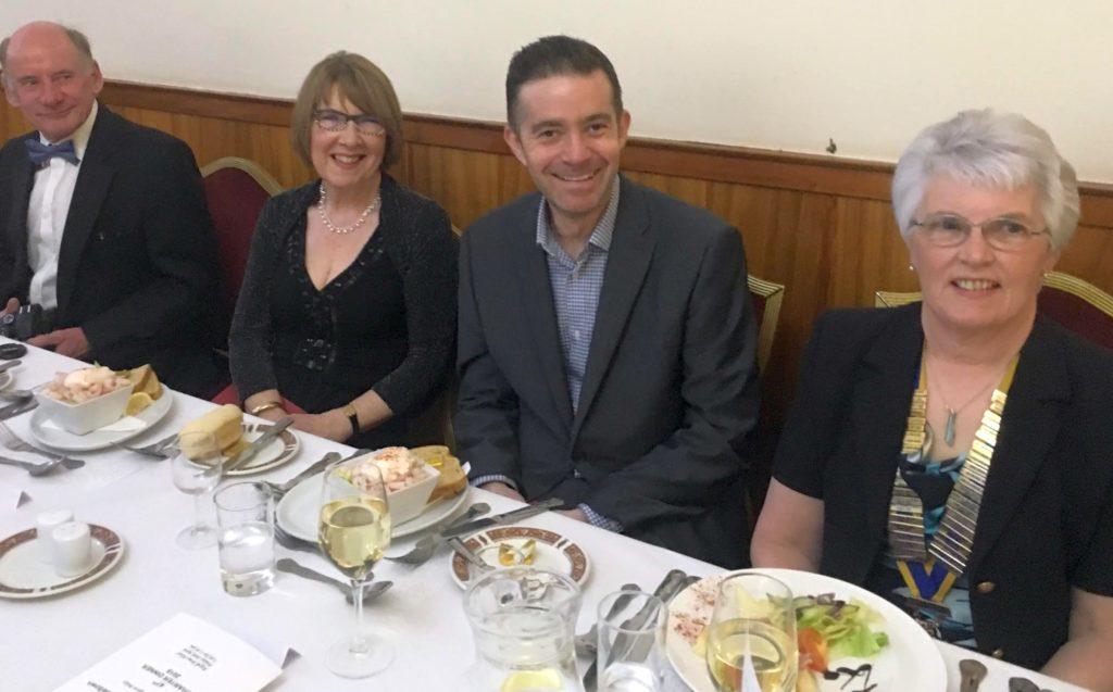 Newsman entertains Rotary's charter dinner