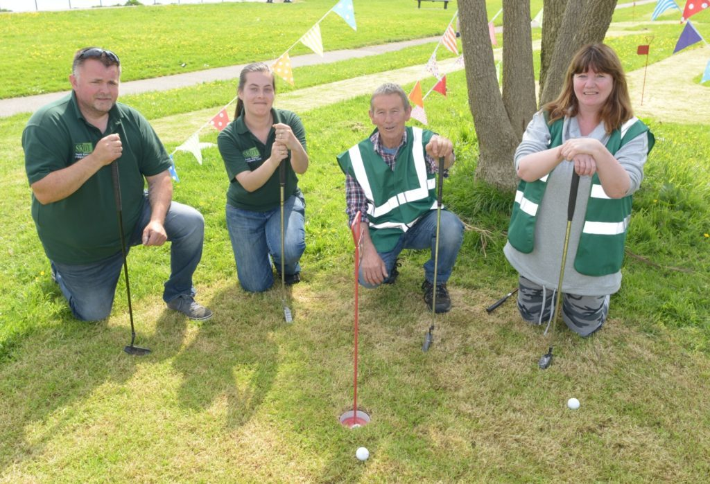 Flags fly as putting green opens