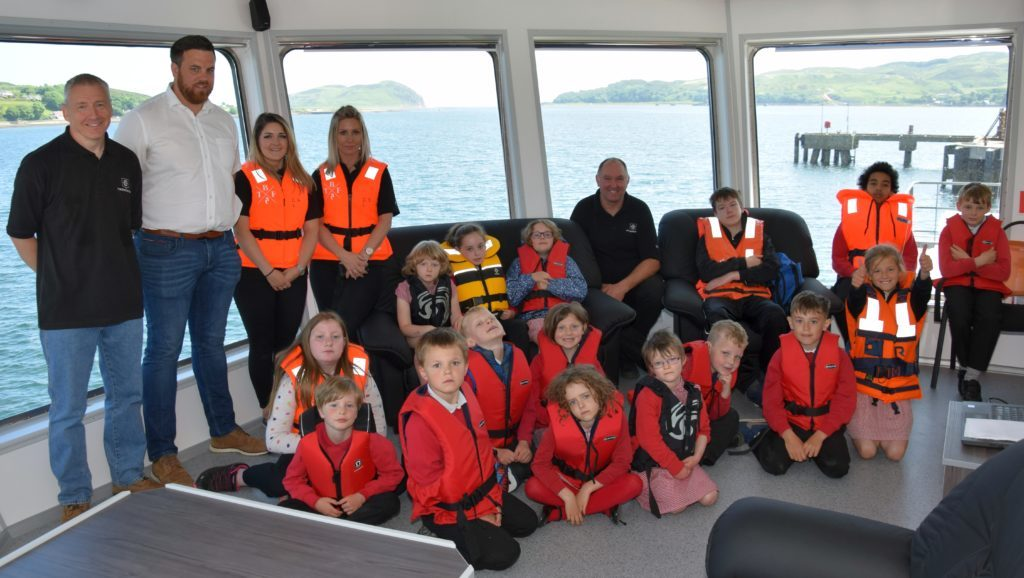 Children tour Scotland's largest salmon feed barge