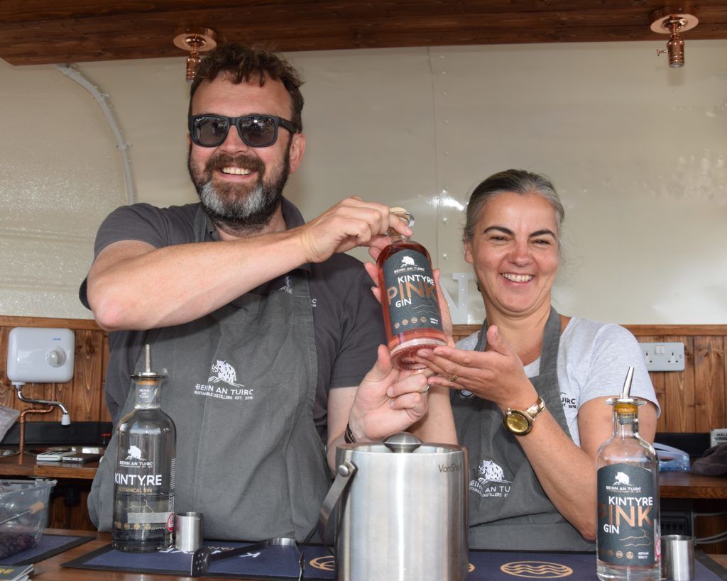 Crowds net first pink gin at Carradale Harbour Day