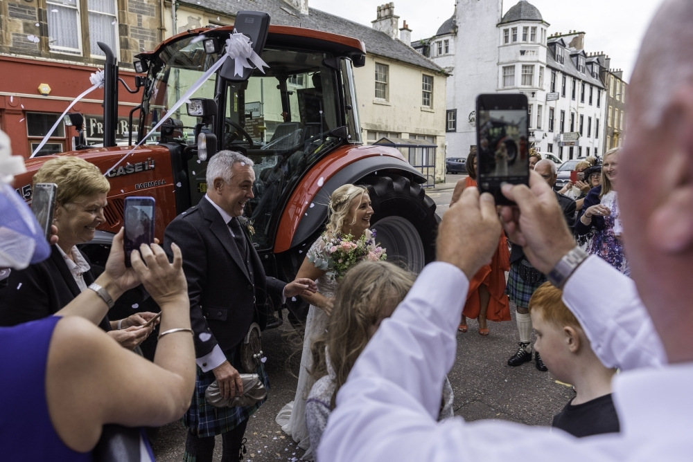 It was a case of tractor love for a bride's carriage