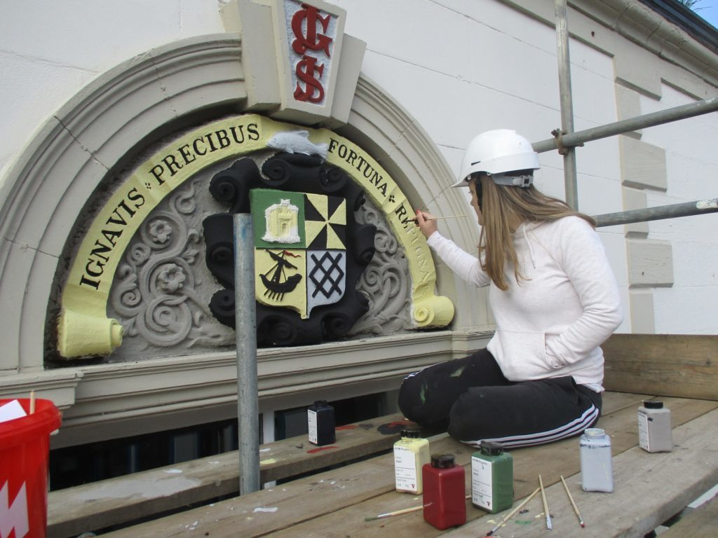 Coat of arms restoration tops off the Town Hall