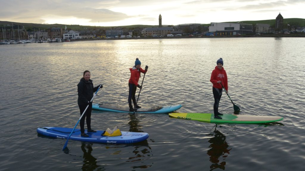 Paddleboarders head out in November sun