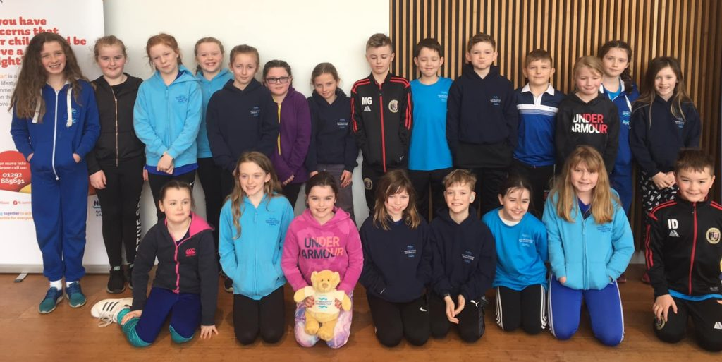 Swimmers dive to mini league round victory