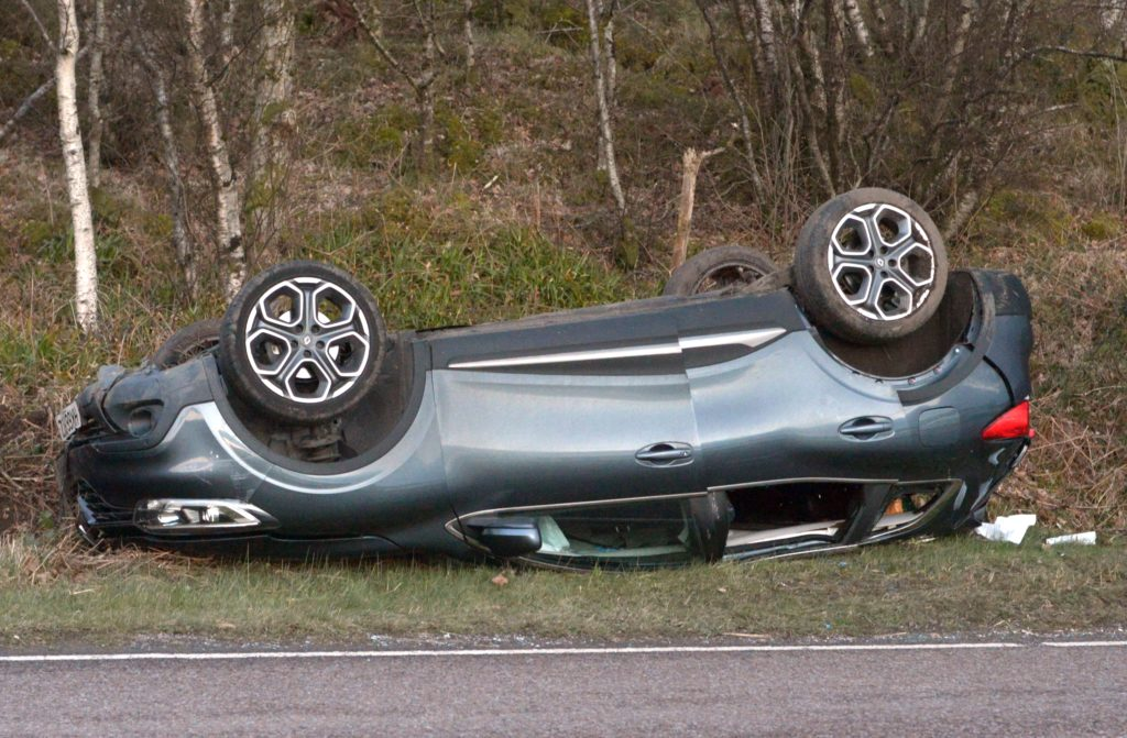 A83 closed after car overturned