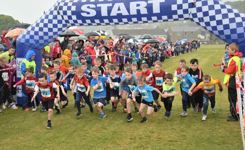 Junior runners smash records despite rain